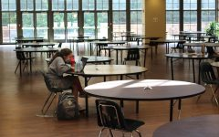 CQ Gintz sitting in the Hutchison dining hall during COVID19 pandemic being used during study hall.
