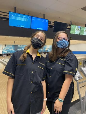 Loralei Forgette and Lucy Hettinger  in their bowling uniforms and masks.