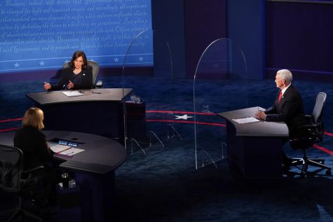 Senator Kamala Harris and Vice President Mike Pence seated at the debate.